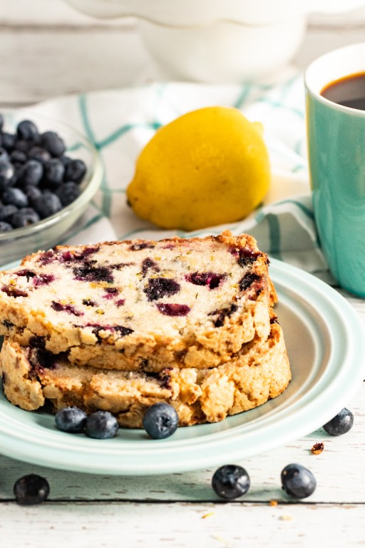 slices of lemon blueberry zucchini bread stacked on a plate