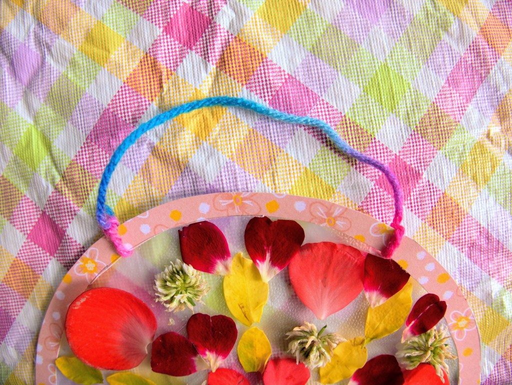 attach a piece of yarn as a hanger for the DIY nature mandala