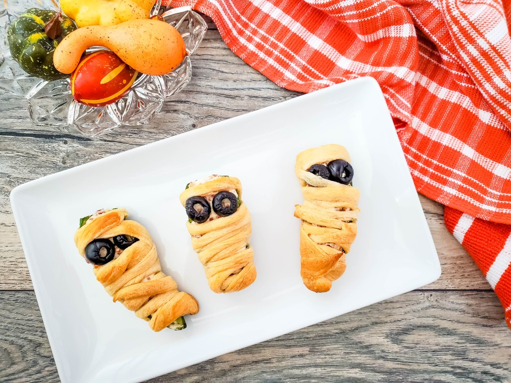 Halloween mummy-wrapped jalapeno poppers