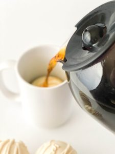 pouring coffee over mocha coffee bombs