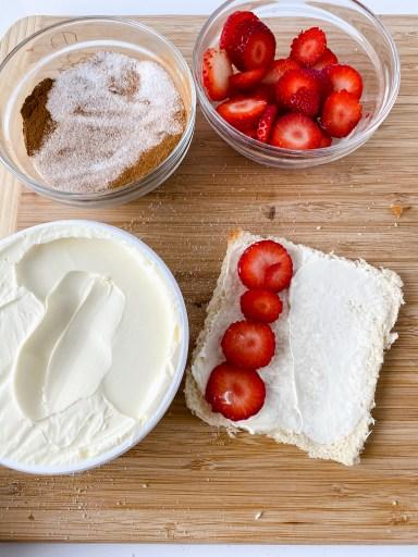 adding mascarpone cheese and strawberries