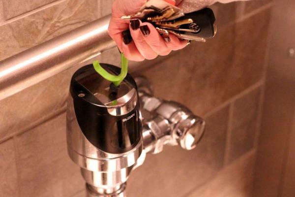 Use the Kooty Key to Flush Toilets