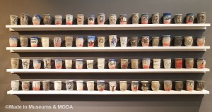 Ceramic cups feature imagery reflecting the artist's military experiences