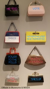 Vintage purses with statements like me too, vote, nevertheless she persisted and girl power
