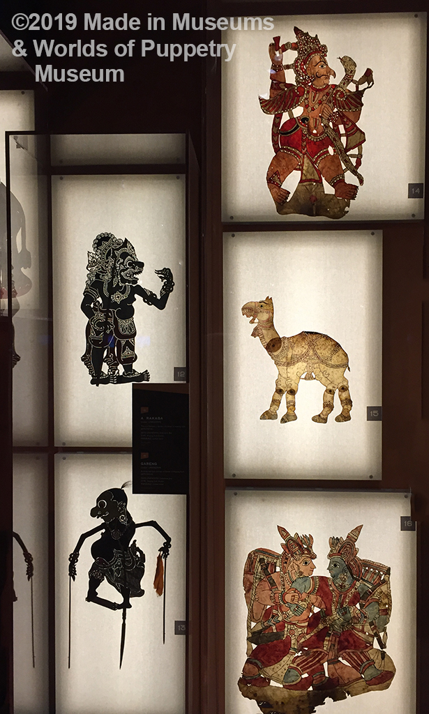 Shadow puppets from India on a wall backlit from behind