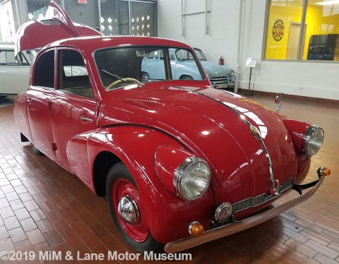 Red Tatra car with front end design that inspired the Volkswagen Beetle