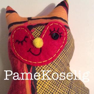 Reclaimed fabric cat plushie.