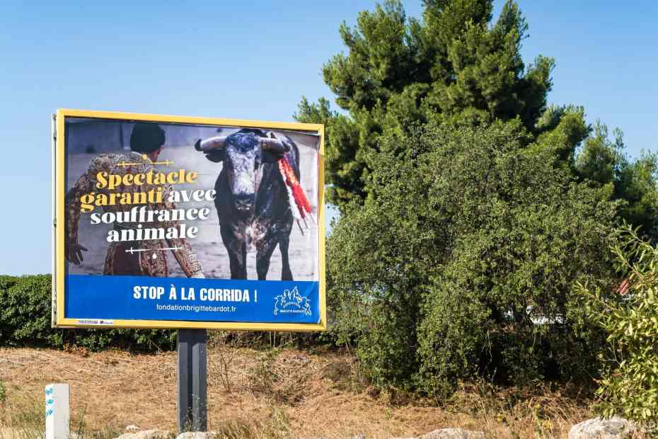 """France, Perpignan, 2021-07-30. Illustration, Since 26 July, the Brigitte Bardot Foundation has put up more than 900 signs in the main towns and departments where bullfighting is practised. However, the signs installed in the town of Beziers have visibly annoyed Robert Menard. The mayor of the town, who is close to the Rassemblement National, responded to the actress with a polemical poster """"With matadors, Brigitte has not always said no"""". Photograph by Arnaud Le Vu / Hans Lucas.France, Perpignan, 2021-07-30. Illustration, Depuis le 26 juillet, la Fondation Brigitte Bardot a installe plus de 900 panneaux sur les principales ville ou departements ou se pratique la corrida. Or, les panneaux installes sur la commune de Beziers ont visiblement agace le Robert Menard. Le maire de la ville et proche du Rassemblement National a repondu a l actrice avec une affiche polemique """"Avec les matadors, Brigitte n a pas toujours dit non"""". Photographie de Arnaud Le Vu / Hans Lucas."""