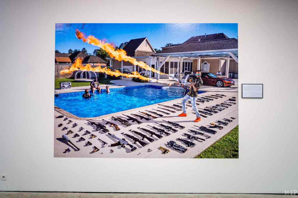 """France, Perpignan, 2021-09-01. Exhibition Gabriele Galimberti, The Ameriguns, Visa pour l Image. Walking into a gun shop in Kansas one day and starting to chat with some customers, I asked them """"How many guns do you have at home? """"I have over 50,"""" one of them said. Soon after, I was at his house to take a picture of him with his entire collection. He was as proud to show off his arsenal as a friend would be to show me his vinyl or watch collection. That s when I decided to travel around the country to photograph, interview and discover the part of America that loves firearms. Photography by Arnaud Le Vu / Hans Lucas."""