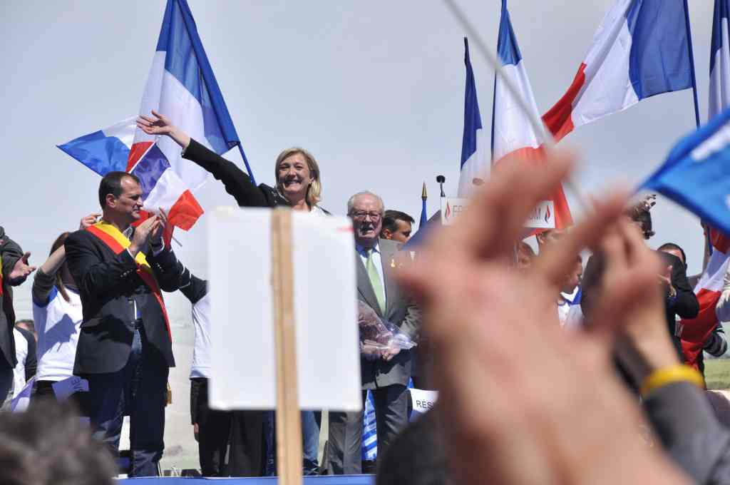 Louis Aliot, Marine Le Pen et Jean-Marie Le Pen le 1er mai 2012. Photo © Blandine Le Cain.
