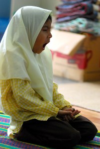 Kindergarten girl in Hijab yawns
