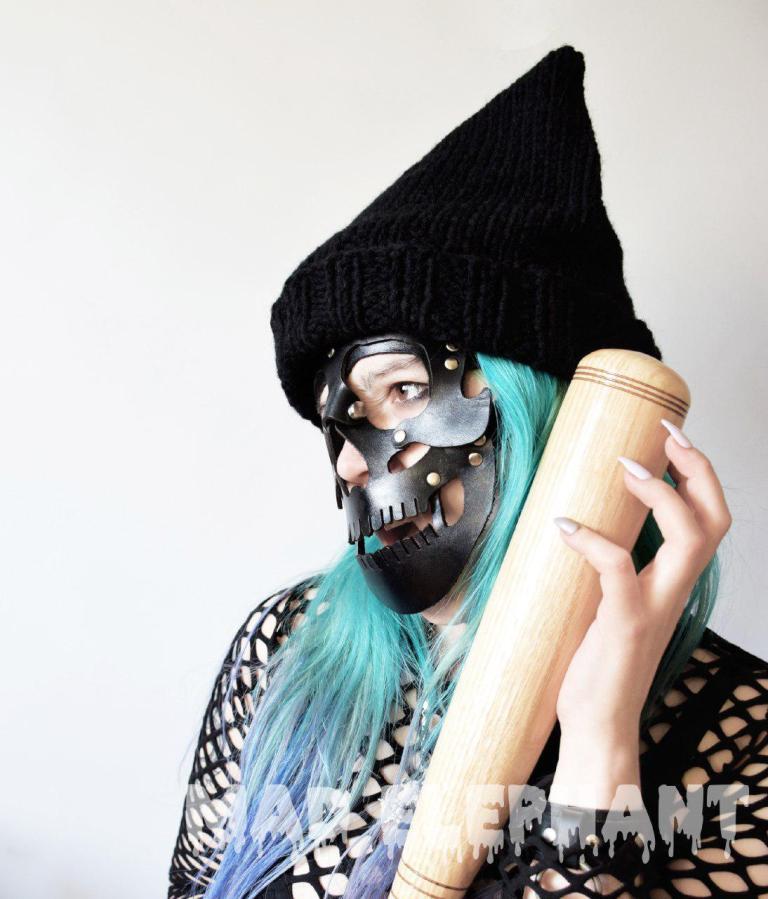 girl in skull mask