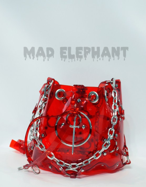 red clear vinyl bag with chains, eyelets and sword pendant