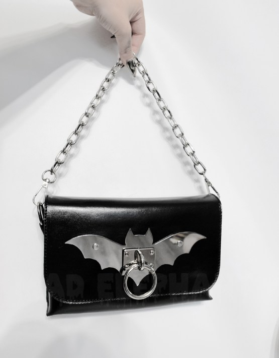 leather purse with chain handle and metal bat detail