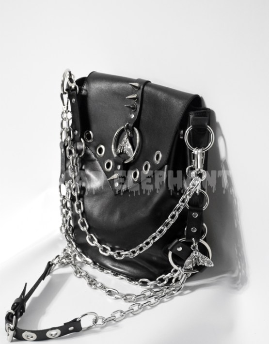black leather hand bag with moth chain harness