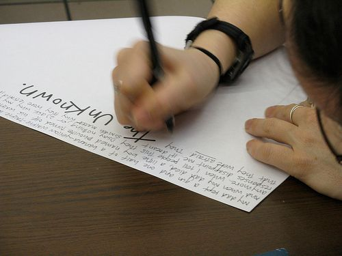 """woman writing by hand """"the unknown"""""""