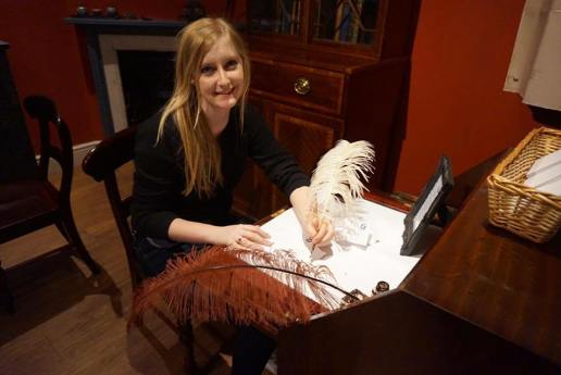 Mady writing with quill