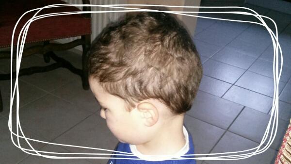 Sa première coupe de cheveux
