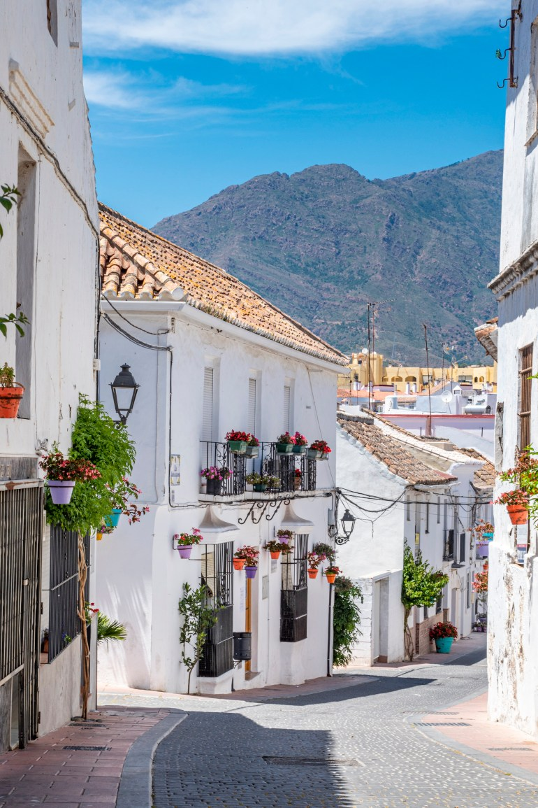 Old town of Estepona set against a mountain