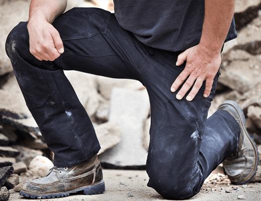 Man kneeling in rugged 1620 workwear pants