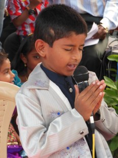 This boy is leading a prayer during one of the skits.