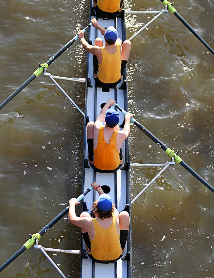 mens four man rowing team from above
