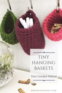 A photo of three small hanging baskets - a crochet pattern to make them