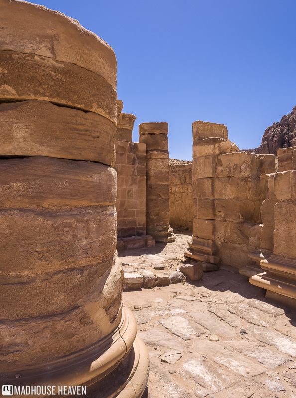 Columns made up of large stone disc still stand partially in the Great Temple, inside Petra, Jordan