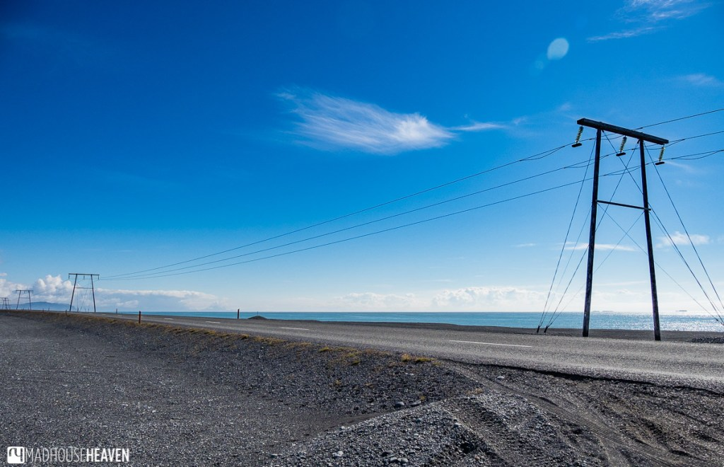 The road approaching the Jökulsárlón Glacier Lagoon in Iceland, with power line pylons along it