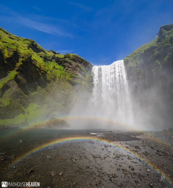 Skógafoss waterfall in Iceland, with a double rainbow in front