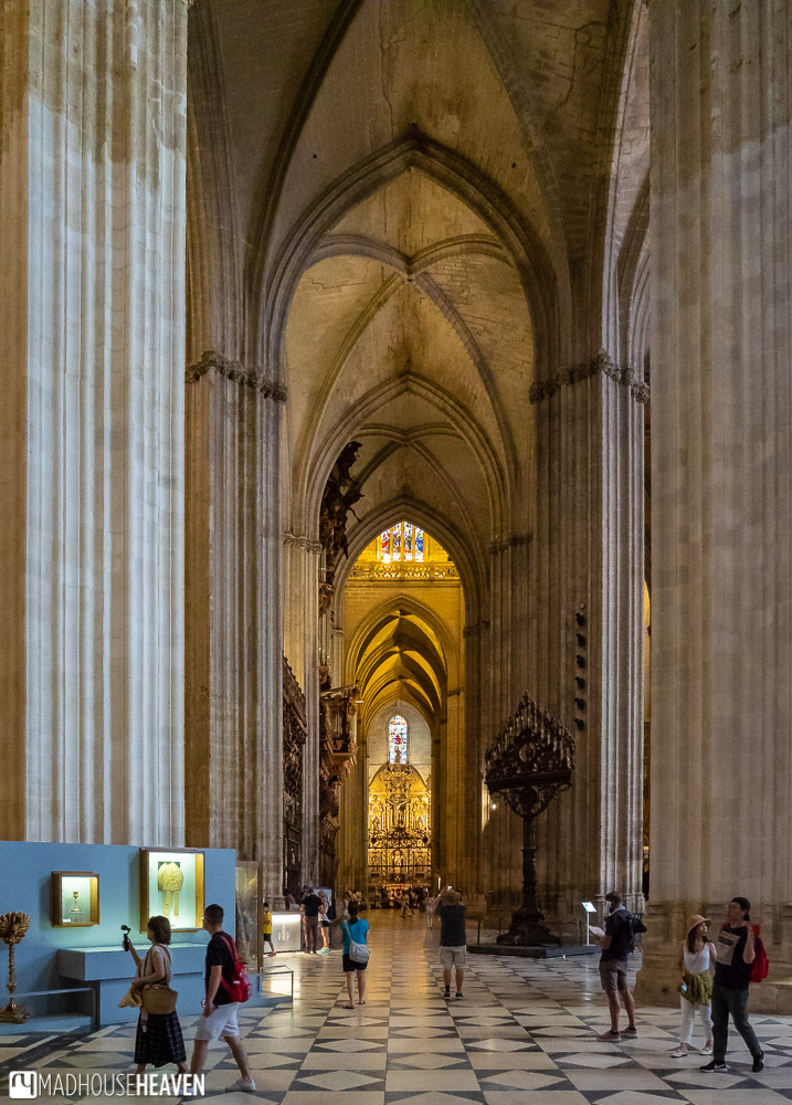 The interior of the Seville Cathedral with its massive stone columns reaching ten stories high
