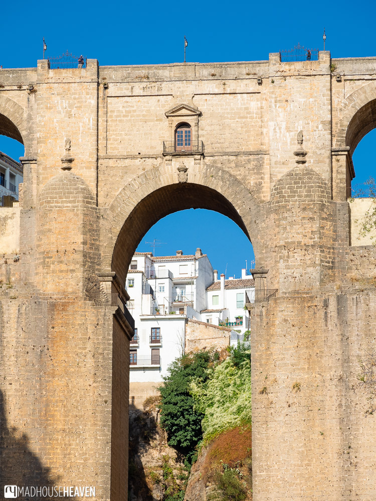 Houses in the new part of Ronda seen through the main arch of the Puente Nuevo