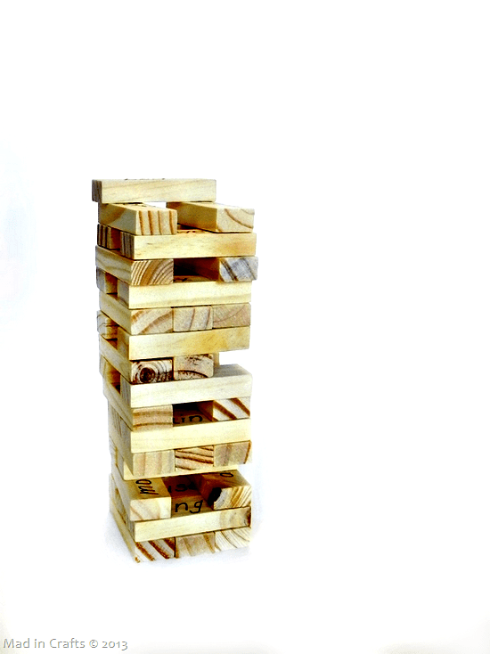 stack of wood Jenga blocks on a white background