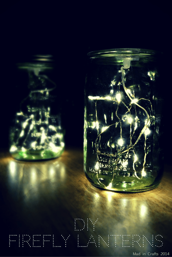 two green mason jars filled with fairy lights