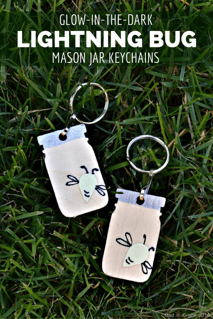 mason jar key chains with glow in the dark fireflies on grass