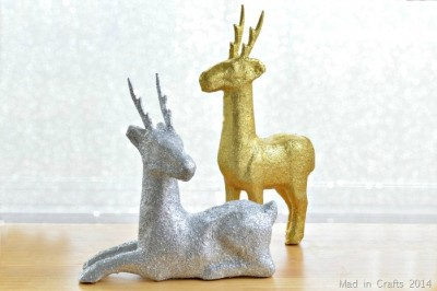DIY glitter paper macher deer in front of a bokeh background