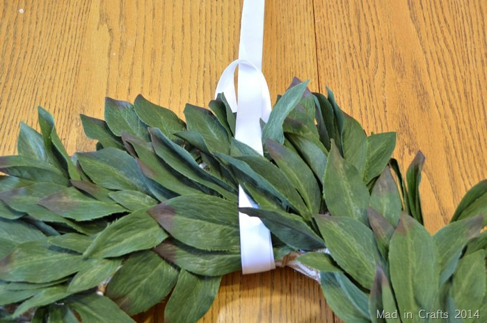 loop ribbon around wreath