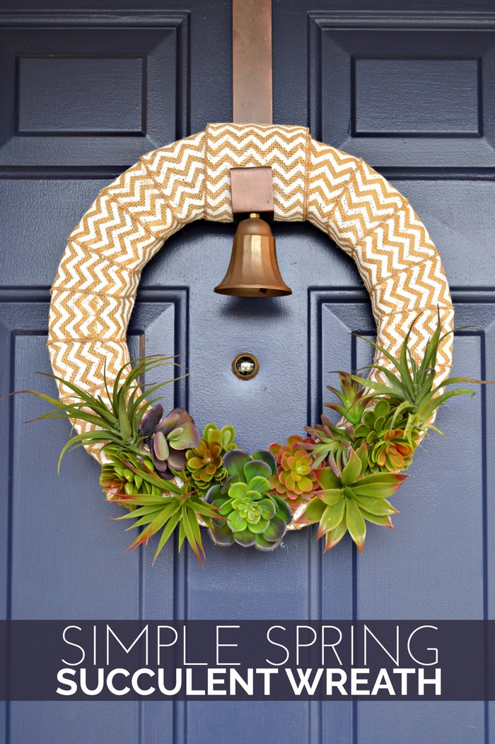 burlap and succulent wreath on a blue door