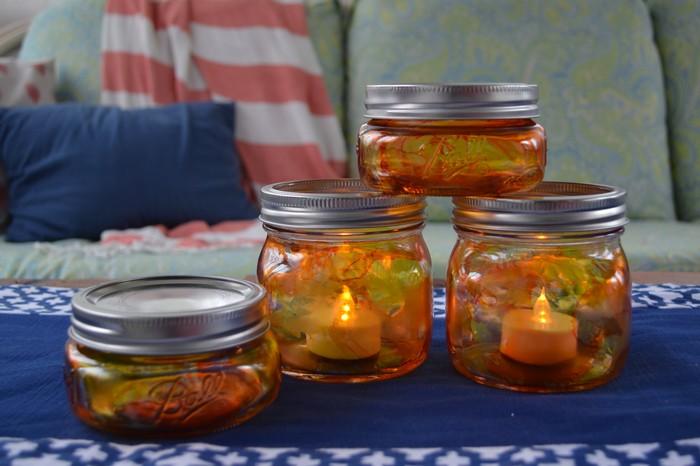 Stacked Pumpkin Mason Jar Luminaries lit with battery powered tea lights