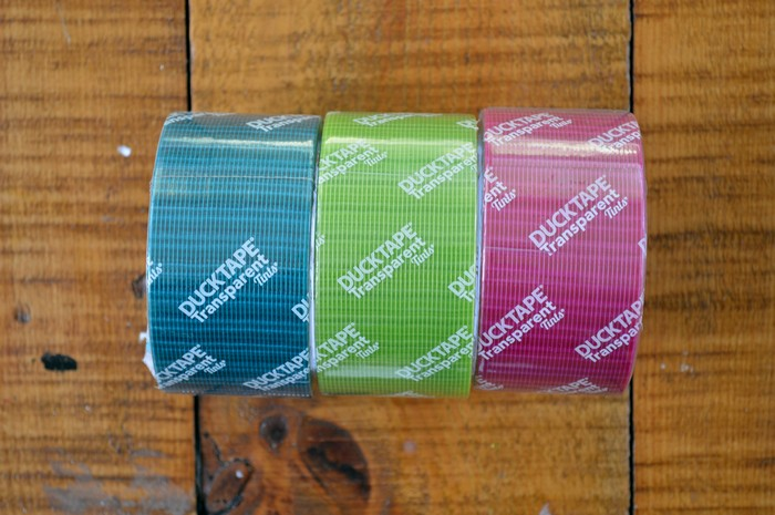 blue, green and pink transparent duck tape on a wood table
