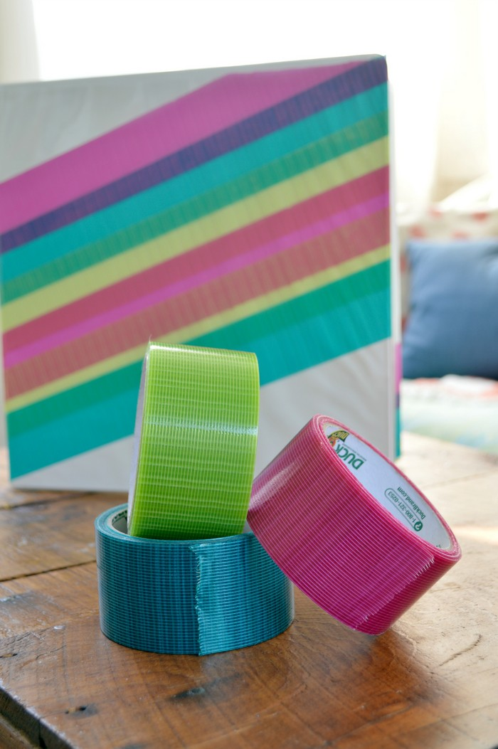 white binder with rolls of colorful transparent duck tape