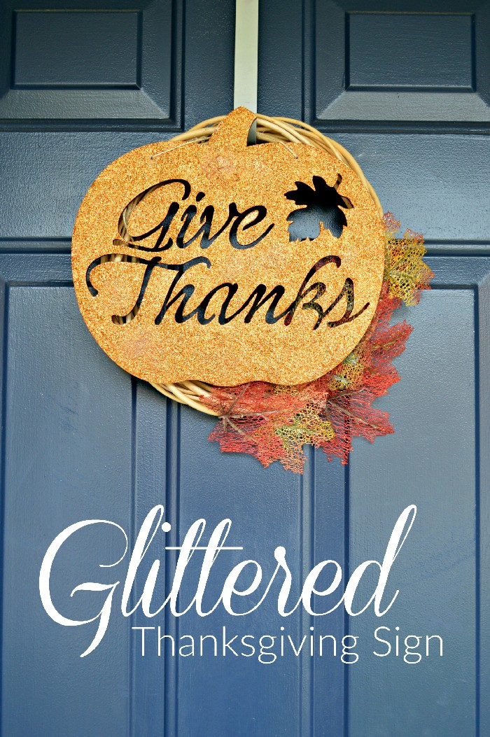 glittery Give Thanks sign wreath on a blue door