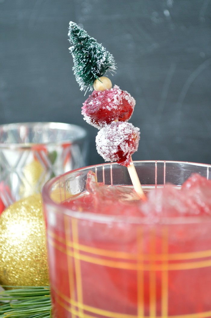 Cranberry cocktail with sugared cranberries on a cocktail pick