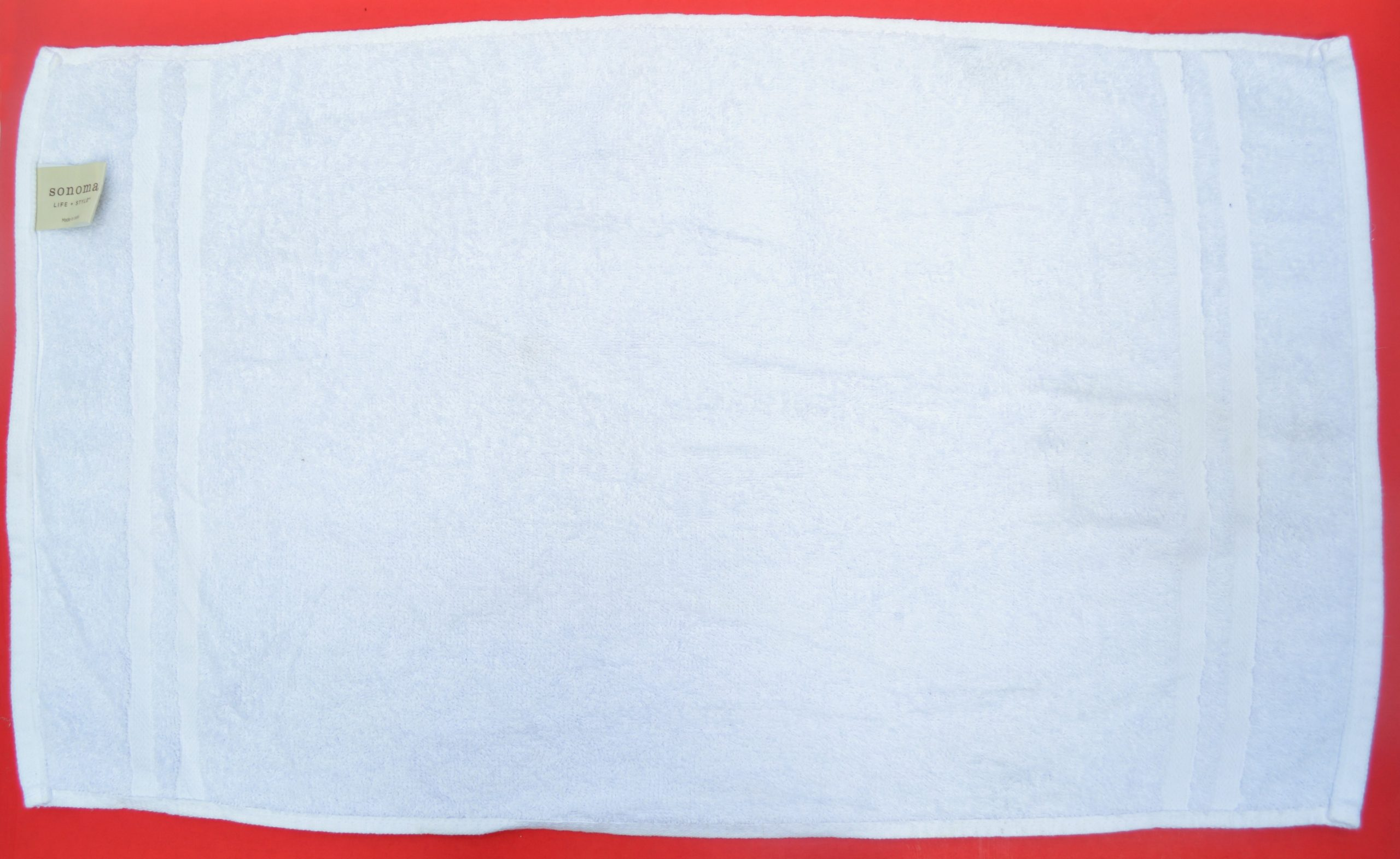 white towel on a red background
