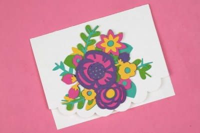 layered paper flower card on a pink background