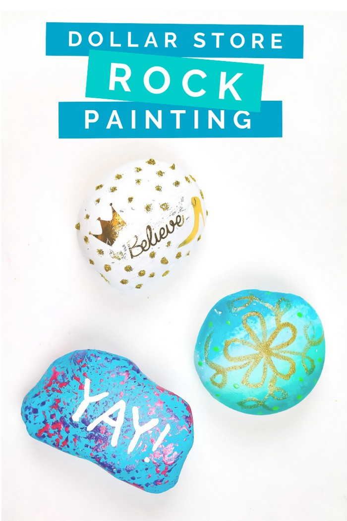 Three painted rocks on a white background