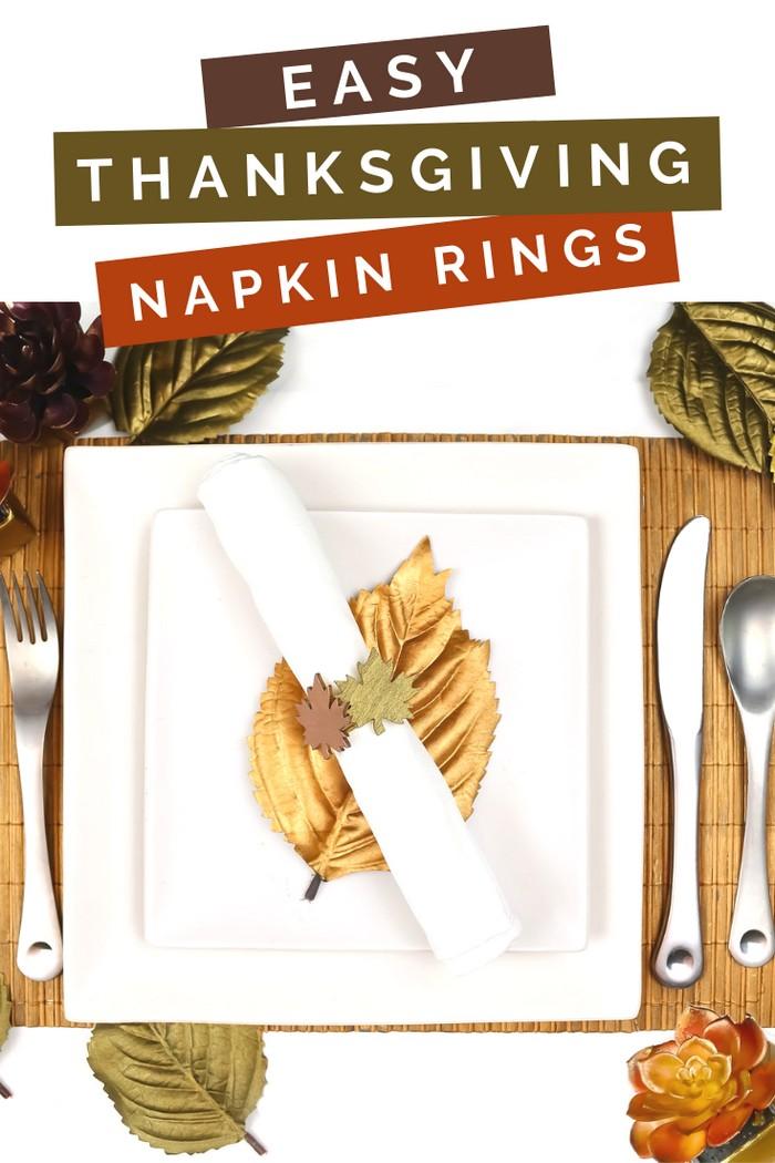 Metallic leaf napkin ring, white napkin, and white plates