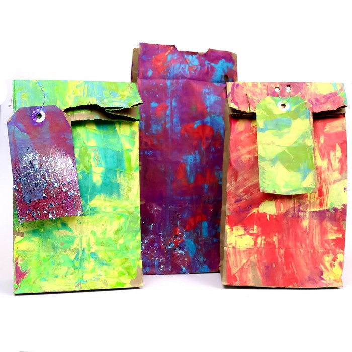 colorfully painted gift bags on a white background