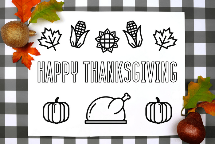 Thanksgiving coloring placemat on a plaid background
