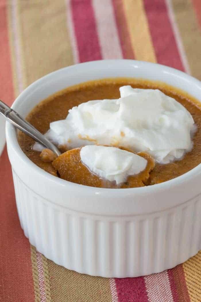 ramekin of pumpkin pie on a plate